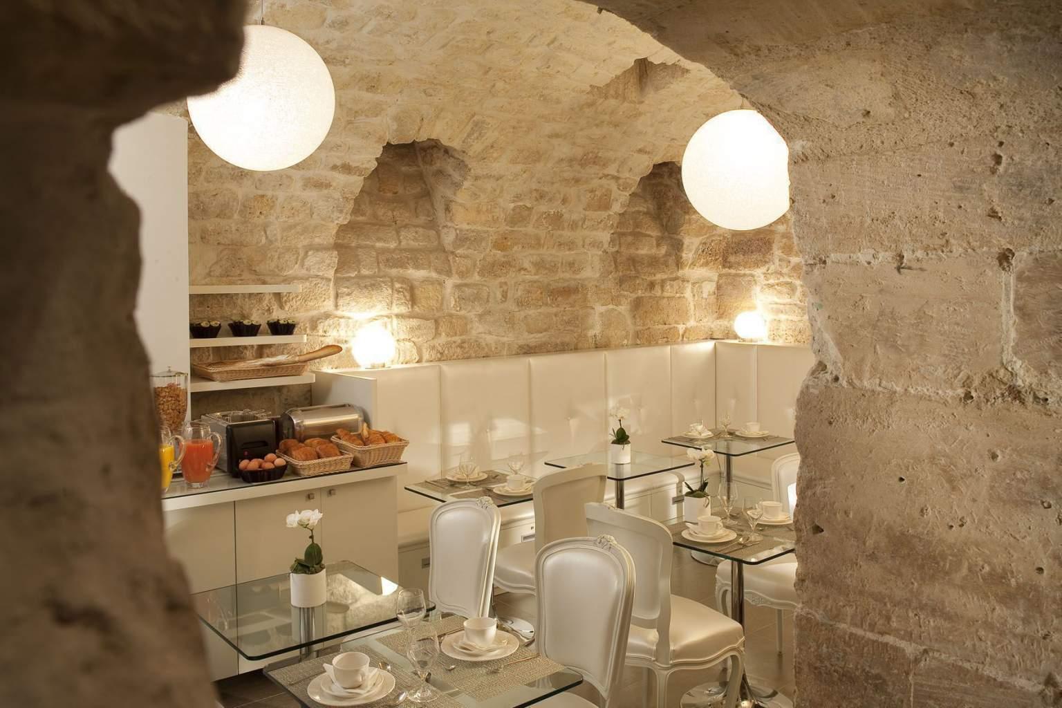 Foto sala pequeno-almoço Hotel Caron Paris